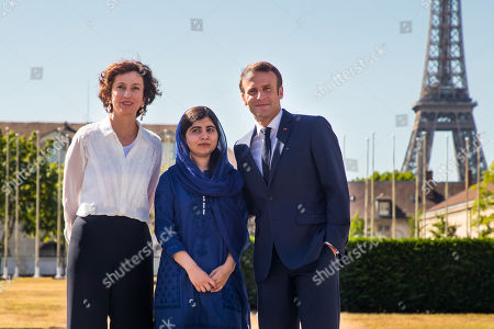 French President Emmanuel Macron (R) arrives with Nobel Peace Prize laureate Malala Yousafzai (C) and UNESCO'S Director-General Audrey Azoulay (L) at the UNESCO'S headquarter during the Education and development G7 ministers Summit, in Paris, France, 05 July 2019.