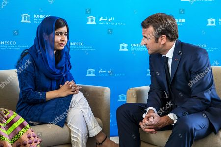 Nobel Peace Prize laureate Malala Yousafzai (L) speaks to French president Emmanuel Macron (R) on the sidelines of the Education and development G7 ministers Summit, in Paris, France, 05 July 2019. France is hosting the rotating presidency of the G7 in 2019. The 45th G7 Summit will be held in August in Biarritz.