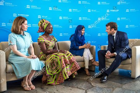Nobel Peace Prize laureate Malala Yousafzai (3-L) speaks to French president Emmanuel Macron (R) on the sidelines of the Education and development G7 ministers Summit, in Paris, France, 05 July 2019. France is hosting the rotating presidency of the G7 in 2019. The 45th G7 Summit will be held in August in Biarritz.