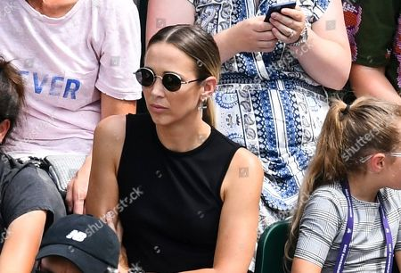Stock Photo of Rebecca Cartwright watching husband Lleyton