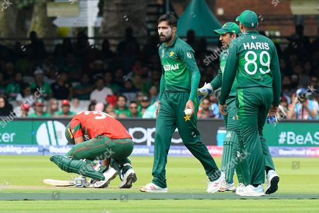 Mohammad Mahmudullah Riyad of Bangladesh goes down after being struck in a sensitive area by a ball bowled by Mohammad Amir of Pakistan during the ICC Cricket World Cup 2019 match between Pakistan and Bangladesh at Lord's Cricket Ground, St John's Wood