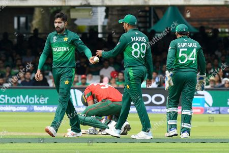 Mohammad Mahmudullah Riyad of Bangladesh goes down in pain after being struck in a sensitive area by a ball bowled by Mohammad Amir of Pakistan during the ICC Cricket World Cup 2019 match between Pakistan and Bangladesh at Lord's Cricket Ground, St John's Wood
