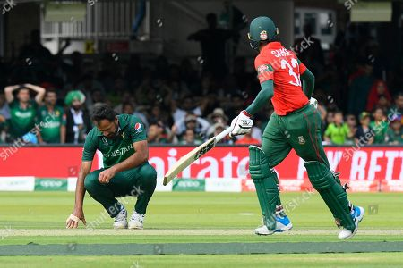 Wahab Riaz of Pakistan slumps to the ground as Mohammad Mahmudullah Riyad of Bangladesh is dropped during the ICC Cricket World Cup 2019 match between Pakistan and Bangladesh at Lord's Cricket Ground, St John's Wood