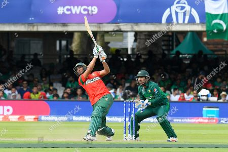 Mohammad Mahmudullah Riyad of Bangladesh hits out and is dropped by Babar Azam of Pakistan during the ICC Cricket World Cup 2019 match between Pakistan and Bangladesh at Lord's Cricket Ground, St John's Wood