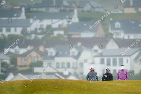 Padraig Harrington of Ireland, Tyrell Hatton of England and Ian Poulter of England on the 3rd fairway