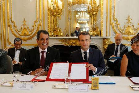 French President Emmanuel Macron (R) attends a meeting with Edouard Fritch, President of French Polynesia at the Elysee Palace in Paris, France, 05 July 2019.