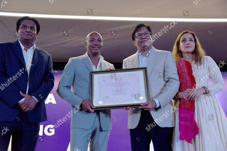 West Indies batsman Brian Lara with Chancellor of DY Patil University Vijay D Patil during a Doctorate Degree ceremony
