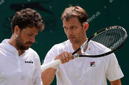 Robin Haase (L) of the Netherlands and Frederik Nielsen of Denmark in action against Ken Skupski of Britain and John-Patrick Smith of Australia during their Men's Doubles match at the Wimbledon Championships at the All England Lawn Tennis Club, in London, Britain, 05 July 2019.