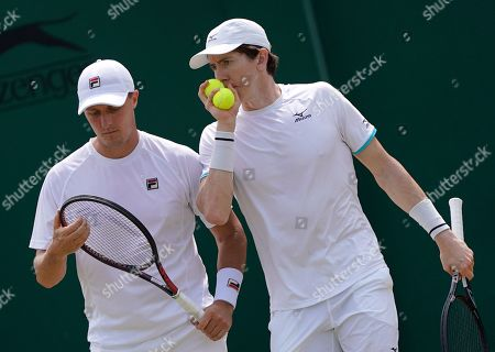 Ken Skupski (L) of Britain and John-Patrick Smith of Australia in action against Robin Haase of the Netherlands and Frederik Nielsen of Denmark during their Men's Doubles match at the Wimbledon Championships at the All England Lawn Tennis Club, in London, Britain, 05 July 2019.
