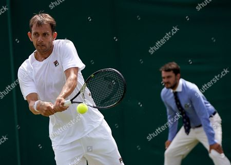 Frederik Nielsen of Denmark in action during the Men's Doubles match with Robin Haase of the Netherlands against Ken Skupski of Britain and John-Patrick Smith of Australia at the Wimbledon Championships at the All England Lawn Tennis Club, in London, Britain, 05 July 2019.
