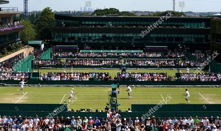 Robin Haase (2nd R) of the Netherlands and Frederik Nielsen (R) of Denmark in action against Ken Skupski of Britain and John-Patrick Smith of Australia during their Men's Doubles match at the Wimbledon Championships at the All England Lawn Tennis Club, in London, Britain, 05 July 2019.