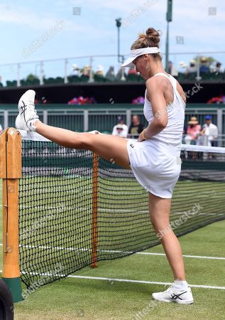 Viktorija Golubic of Switzerland stretches as she plays Dayana Yastremska of Ukraine in their third round match during the Wimbledon Championships at the All England Lawn Tennis Club, in London, Britain, 05 July 2019.