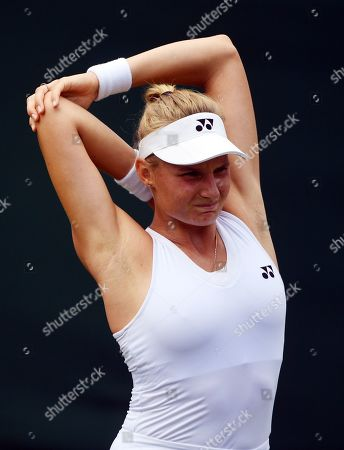 Dayana Yastremska of Ukraine stretches as she plays Viktorija Golubic of Switzerland in their third round match during the Wimbledon Championships at the All England Lawn Tennis Club, in London, Britain, 05 July 2019.