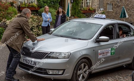Ep 8535 Monday 15th July 2019  Lydia, as played by Karen Blick, explains she still plans to leave, but Sam Dingle, as played by James Hooton, refuses to let her. After stepping outside for some air, she secretly orders a taxi to pick her up. Sam rushes after her and stands in front of the car.