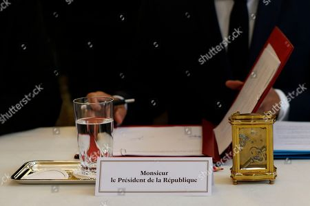 Stock Image of The place card for French President Emmanuel Macron and the table clock are seen during a meeting with the president of French Polynesia, Edouard Fritch (not pictured), at the Elysee Palace in Paris, France, 05 July 2019.