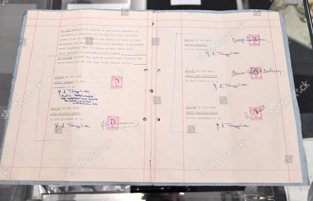 A view of the 1962 original and first management contract between members of The Beatles and English music entrepreneur Brian Epstein, which was signed by John Lennon, Paul McCartney, George Harrison and Pete Best.