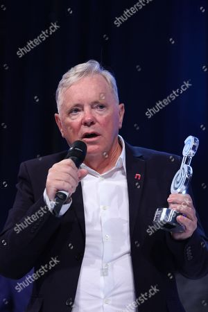 Bernard Sumner accepts his award