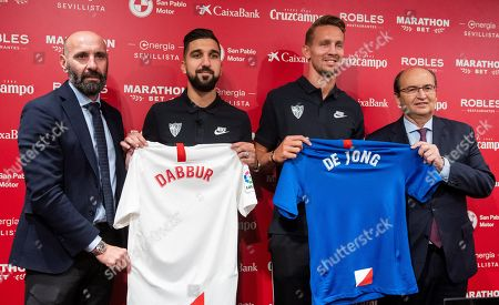 Stock Image of Dutch strike Luuk de Jong (2-R) and Israeli forward Munas Dabbur (2-L) pose with their new jerseys next to Spanish team Sevilla FC's President Jose Castro (R) and Sport Director Ramon Rodriguez 'Monchi' (L) during a press conference in Seville, southern Spain, 05 July 2019.