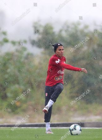Peru's Raul Ruidiaz kicks a ball during a training session in Rio de Janeiro, Brazil,. Peru will face Brazil for the Copa America final soccer match on July, 7