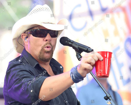 Country music recording artist Toby Keith holds a red Solo cup as he performs on NBC's Today show at Rockefeller Plaza, in New York