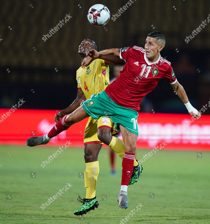 FRANCE OUT Faycal Fajr of Morocco and Anane Tidjani of Benin during the African Cup of Nations match between Marocco and Benin at the Al Salam Stadium in Cairo, Egypt