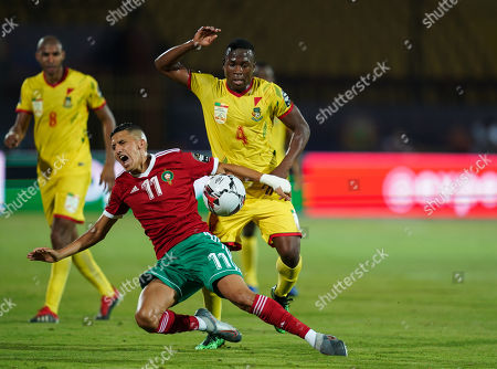 FRANCE OUT Anane Tidjani of Benin fouling Faycal Fajr of Morocco during the African Cup of Nations match between Marocco and Benin at the Al Salam Stadium in Cairo, Egypt