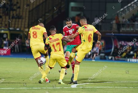 FRANCE OUT Youssef En-Nesyri of Morocco tackled by Olivier Jacques Verdon of Benin during the African Cup of Nations match between Marocco and Benin at the Al Salam Stadium in Cairo, Egypt