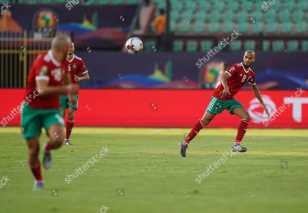 Stock Picture of FRANCE OUT Karim El Ahmadi Aroussi of Morocco passing the ball during the African Cup of Nations match between Marocco and Benin at the Al Salam Stadium in Cairo, Egypt