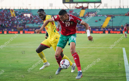 FRANCE OUT MoiÌË?se Wilfrid Adilehou of Benin and Youssef En-Nesyri of Morocco challenging for the ball during the African Cup of Nations match between Marocco and Benin at the Al Salam Stadium in Cairo, Egypt