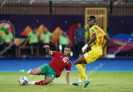 FRANCE OUT Younes Belhanda of Morocco passing the ball in front of Abdou Kaled Adenon of Benin during the African Cup of Nations match between Marocco and Benin at the Al Salam Stadium in Cairo, Egypt