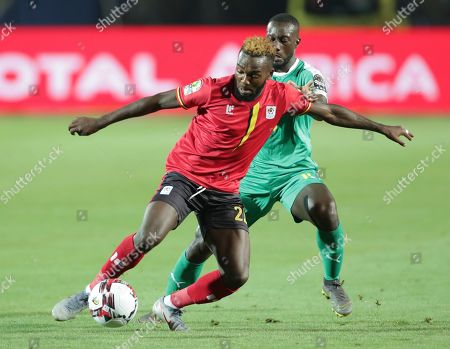 Uganda's Abdu Lumala in action in front ofSenegal's Youssouf Sabaly during the African Cup of Nations round of 16 soccer match between Uganda and Senegal in Cairo International stadium in Cairo, Egypt