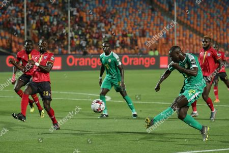 Senegal's Youssouf Sabaly shoot during the African Cup of Nations round of 16 soccer match between Uganda and Senegal in Cairo International stadium in Cairo, Egypt