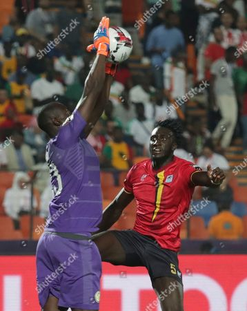 Senegal's Alfred Ndiaye saves in front of Uganda's Bevis Kristofer Kizito Mugabi during the African Cup of Nations round of 16 soccer match between Uganda and Senegal in Cairo International stadium in Cairo, Egypt