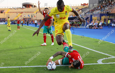Benin's Jodel Dossou jumps over Morocco's Manuel Marouan Da Costa Trindade during the African Cup of Nations round of 16 soccer match between Morocco and Benin in Al Salam stadium in Cairo, Egypt