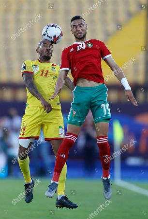 Benin's Emmanuelle Imorou, left, and Morocco's Youssef En-Nesyri jump for the ball during the African Cup of Nations round of 16 soccer match between Morocco and Benin in Al Salam stadium in Cairo, Egypt