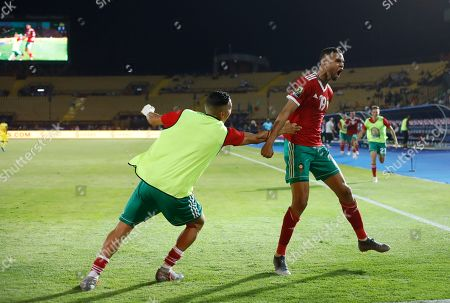 Morocco's Youssef En-Nesyri celebrates after he scored during the African Cup of Nations round of 16 soccer match between Morocco and Benin in Al Salam stadium in Cairo, Egypt