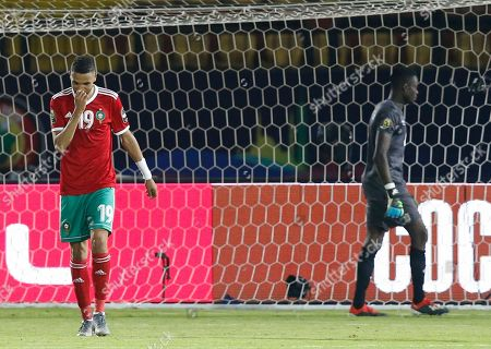 Morocco's Youssef En-Nesyri reacts after he missed during a penalty shoot out during the African Cup of Nations round of 16 soccer match between Morocco and Benin in Al Salam stadium in Cairo, Egypt