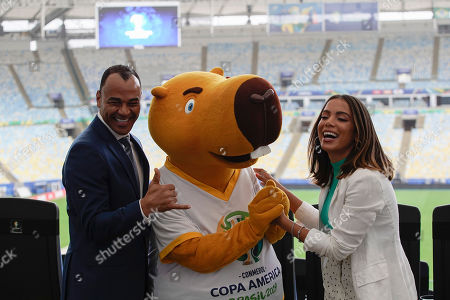 Brazilian singer Anitta, right, and former soccer player Cafu, pose for a photo with the Copa America mascot Zizito, on the sidelines of a press conference regarding the upcoming Copa America title match, in Rio de Janeiro, Brazil, . Brazil and Peru will meet up for the Copa America championship match on Sunday