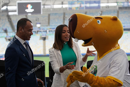 Brazilian singer Anitta, center, former soccer player Cafu, and the Copa America mascot Zizito, chat on the sidelines of a press conference regarding the upcoming Copa America title match, in Rio de Janeiro, Brazil, . Brazil and Peru will meet up for the Copa America championship match on Sunday