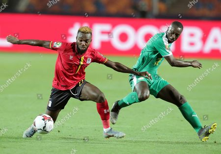 Senegal's Youssouf Sabaly (R) in action Uganda's Abdu Lumala (L) during the 2019 Africa Cup of Nations (AFCON 2019) round of 16 soccer match between Uganda and Senegal in Cairo Stadium in Cairo, Egypt, 05 July 2019.