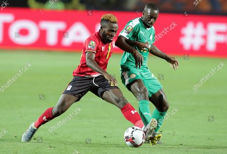 Stock Picture of Senegal's Youssouf Sabaly (R) in action Uganda's Abdu Lumala (L) during the 2019 Africa Cup of Nations (AFCON 2019) round of 16 soccer match between Uganda and Senegal in Cairo Stadium in Cairo, Egypt, 05 July 2019.