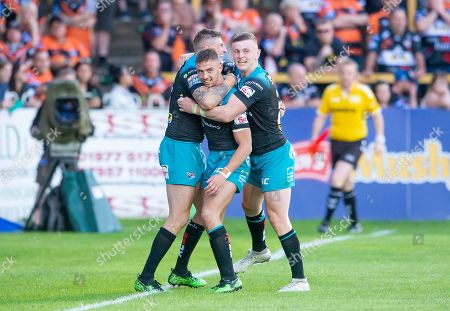 Leeds's Jack Walker is congratulated by Liam Suitcliffe & Harry Newman on scoring a try against Castleford.