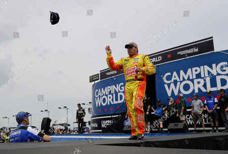 Ryan Newman throws a cap to the crowd during driver introductions before a NASCAR Cup Series auto race at Chicagoland Speedway in Joliet, Ill