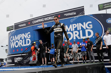 Aric Almirola waves to the crowd during drivers introduction before the NASCAR Cup Series auto race at Chicagoland Speedway in Joliet, Ill