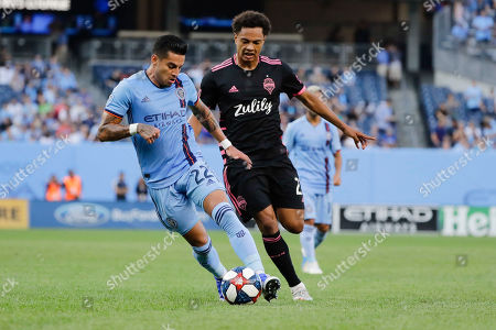 New York City's Ronald Matarrita (22) and Seattle Sounders's Henry Wingo (23) vie for the ball during the first half of an MLS soccer match, in New York