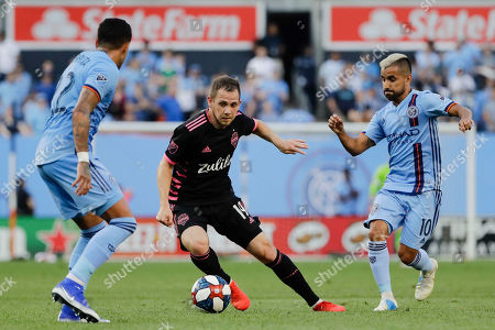 Seattle Sounders's Harrison Shipp (19) protects the ball from New York City's Ronald Matarrita (22) Maximiliano Moralez (10) during the first half of an MLS soccer match, in New York