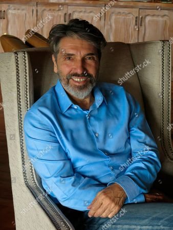 """Argentine-born musician Diego Verdaguer poses for a portrait in his home in Mexico City. Verdaguer will celebrate his 50 year career with the Italian pop songs he grew up listening to, in his upcoming album """"Corazón Bambino"""", which includes the single """"Cuando, cuando, cuando"""