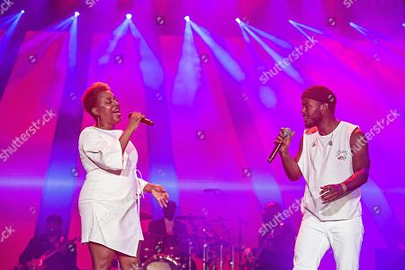 Stock Picture of Ledisi; Luke James. Ledisi, left, and Luke James perform at the 2019 Essence Festival at the Mercedes-Benz Superdome, in New Orleans