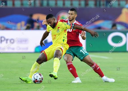 Stephane Sessegnon (L) of Benin and Younes Belhanda of Morocco in action during the 2019 Africa Cup of Nations (AFCON 2019) round of 16 soccer match between Morocco and Benin at the Al Salam Stadium in Cairo, Egypt, 05 July 2019