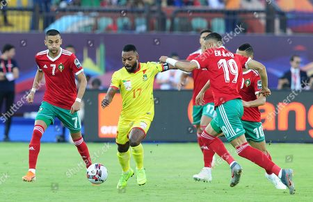 Stephane Sessegnon (C) of Benin and Youssef En-Nesyri (R) of Morocco in action during the 2019 Africa Cup of Nations (AFCON 2019) round of 16 soccer match between Morocco and Benin at the Al Salam Stadium in Cairo, Egypt, 05 July 2019